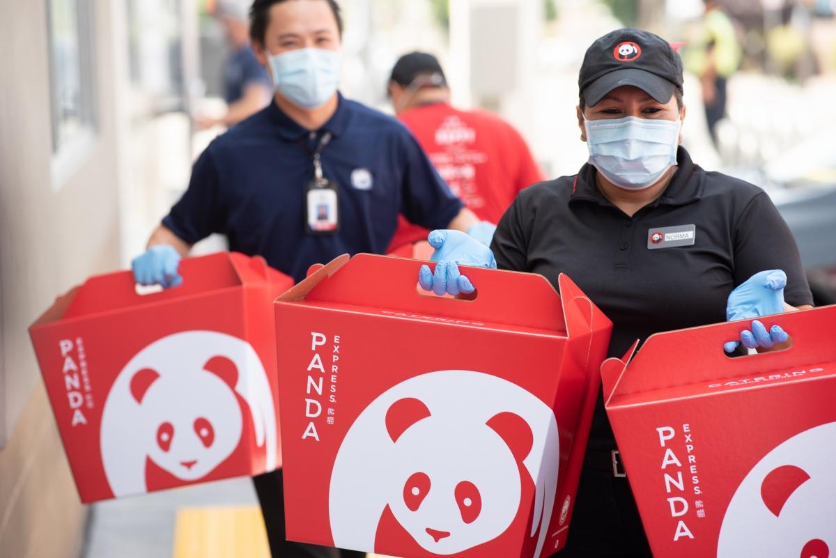 Panda representatives donating checks in Rosemead